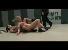 Lesbians fight with strapon
